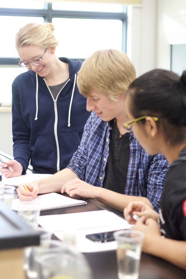 Sara works with classmates in a small, professor-directed lab at CMU.