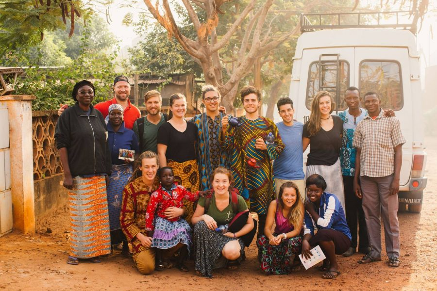 Liam Kachkar (in the blue shirt) with Outtatown in Burkina Faso last semester