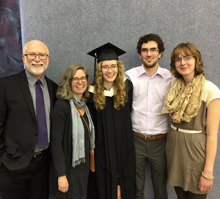 Emily Hamm, (centre), with her family on graduation day at Canadian Mennonite University in June, 2017.