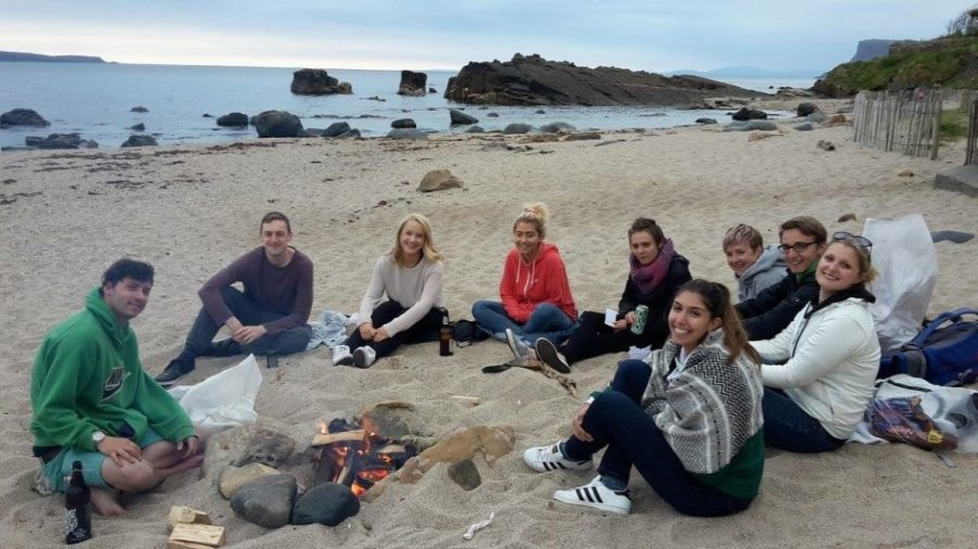 Emilie Roussis sits on the beach with a circle of friends, near Corrymeela, Northern Ireland.