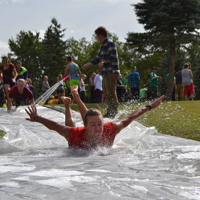 Nicole Ternowsky - A student slides down a slip and slide during CMU's GO Olympics!