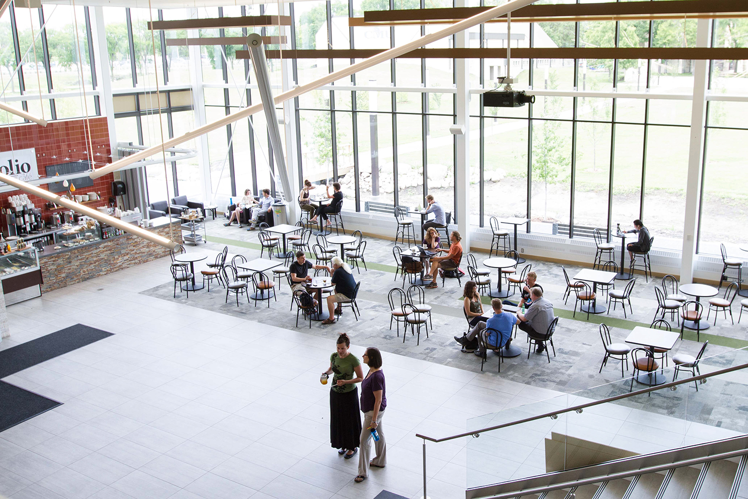6 study tips — A view of Marpeck Commons from the Mezzanine level, down to the tables and chairs below, with Folio Cafe and the wall of glass letting in so much natural light.