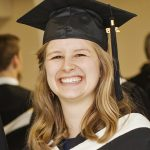 Laura Carr-Pries in her graduation gown and cap.