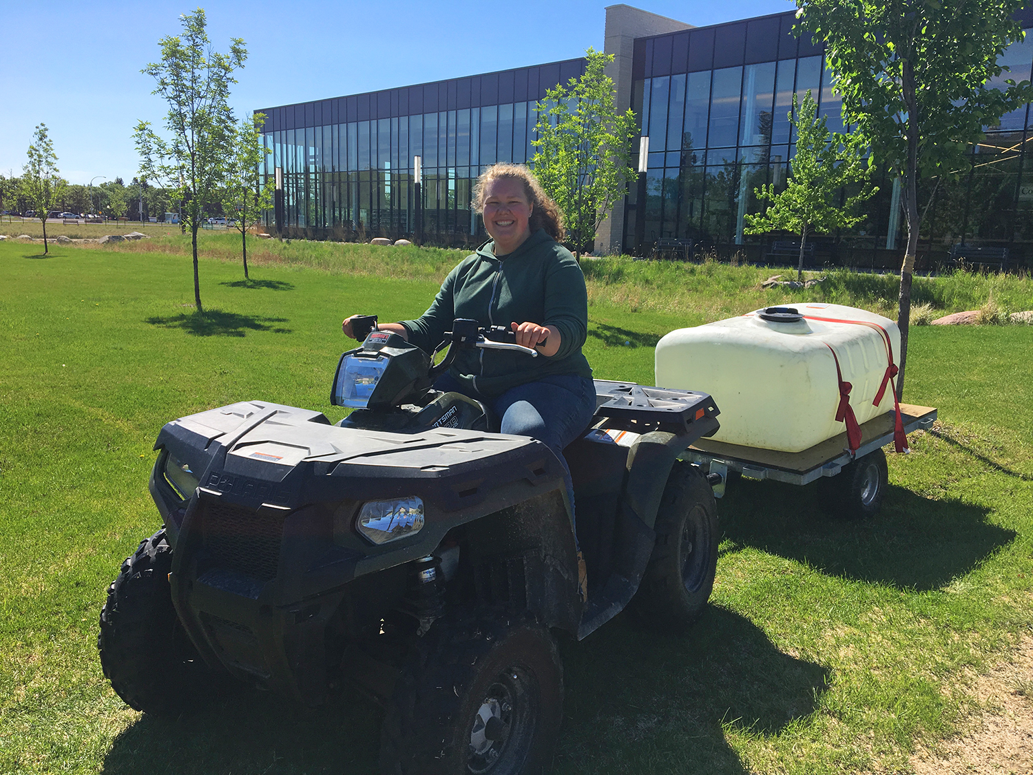 Summer jobs: On-campus employment at CMU. Rebecca Janzen rides 'the quad' for her summer job as a groundskeeper at CMU.
