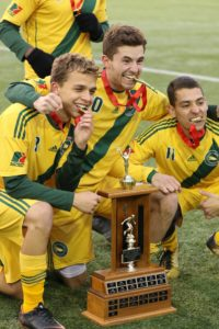 Ryan Jenson with teammates and MCAC trophy
